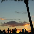 Vacation Image of Young at a Sunset Beach Party — Stock Photo