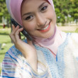 Muslim young girl make a phone call — Stock Photo
