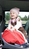 Girl in car seat — Stock Photo