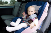 Girl in car seat — Stock Photo