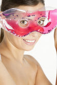 Woman with cooling facial mask — Stock Photo