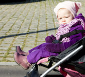 Toddler in pram — Stock Photo