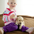 Toddler with puppy — Stock Photo