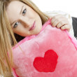 Stock Photo: Woman holding a pillow