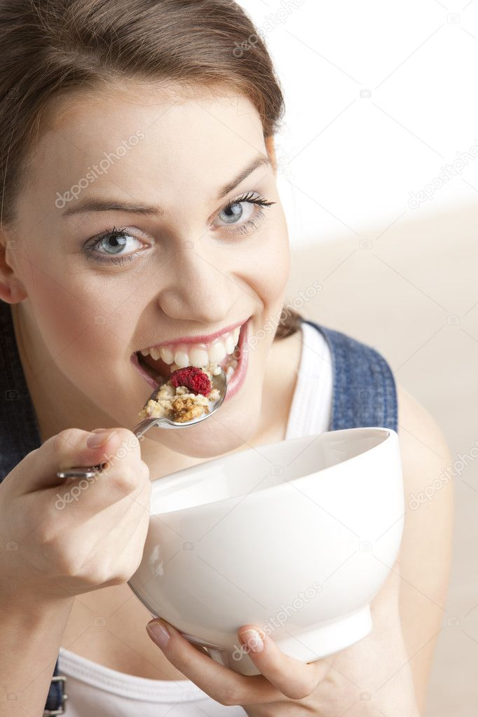 Portrait of woman eating cereals   #2798682
