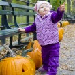 Stock Photo: Toddler with pumpkins