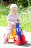 Girl on toy motorcycle — Stock Photo
