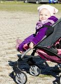 Toddler in pram — Stock Photo