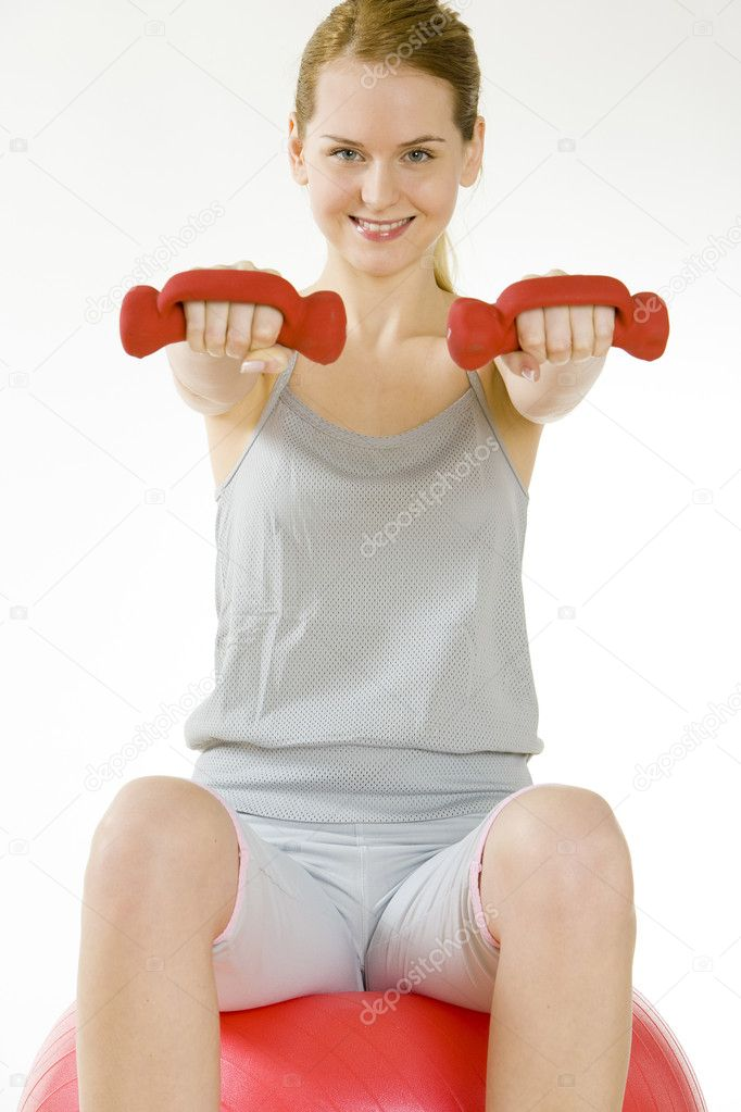 Exercising woman sitting on ball  Stock Photo #2927453