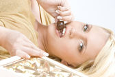 Woman with chocolate — Stock Photo