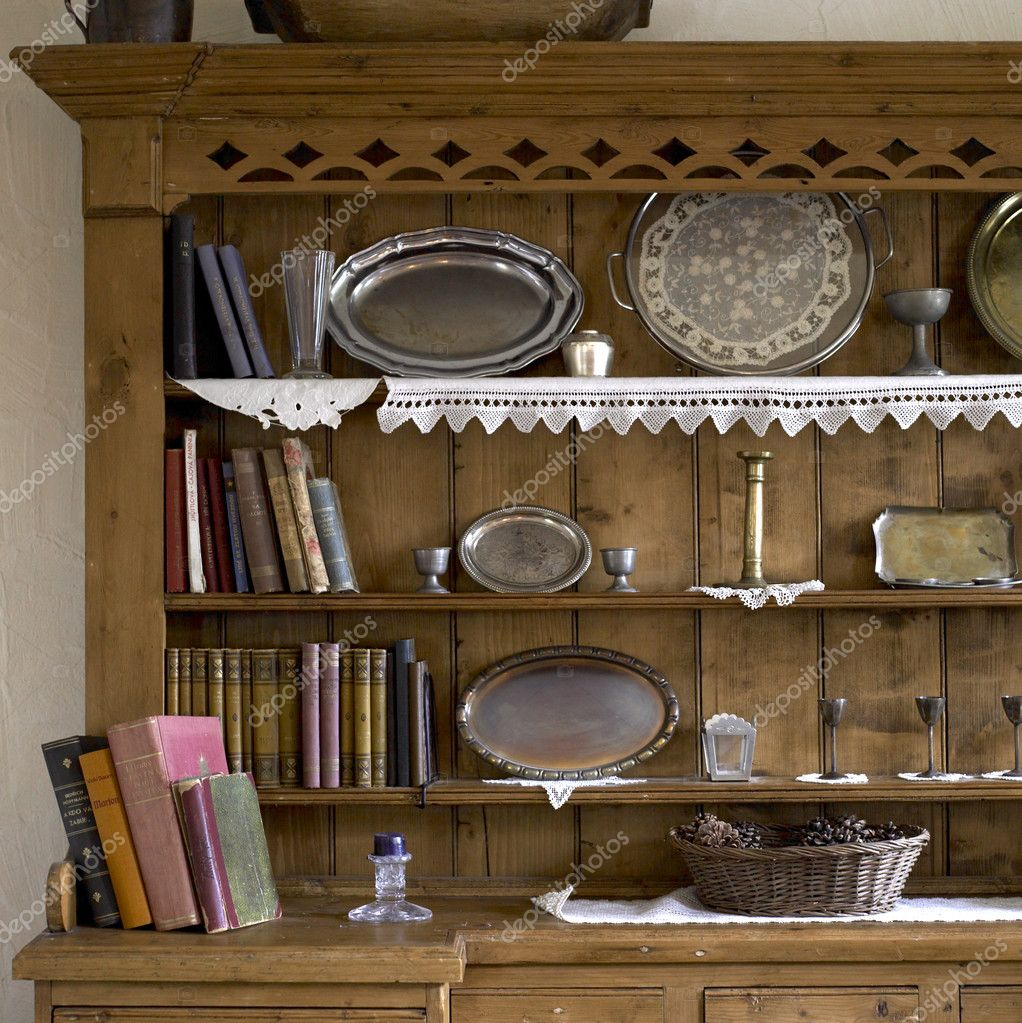 Cupboard with plates and books — Foto Stock #3039748