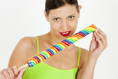 Woman with a lollipop — Stock Photo