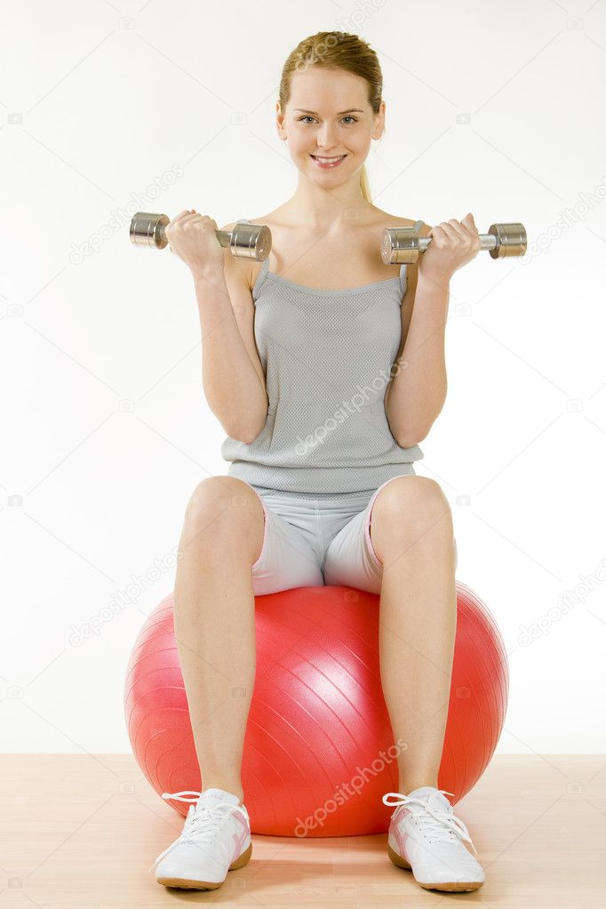 Exercising woman sitting on the ball — Stock Photo #3371768