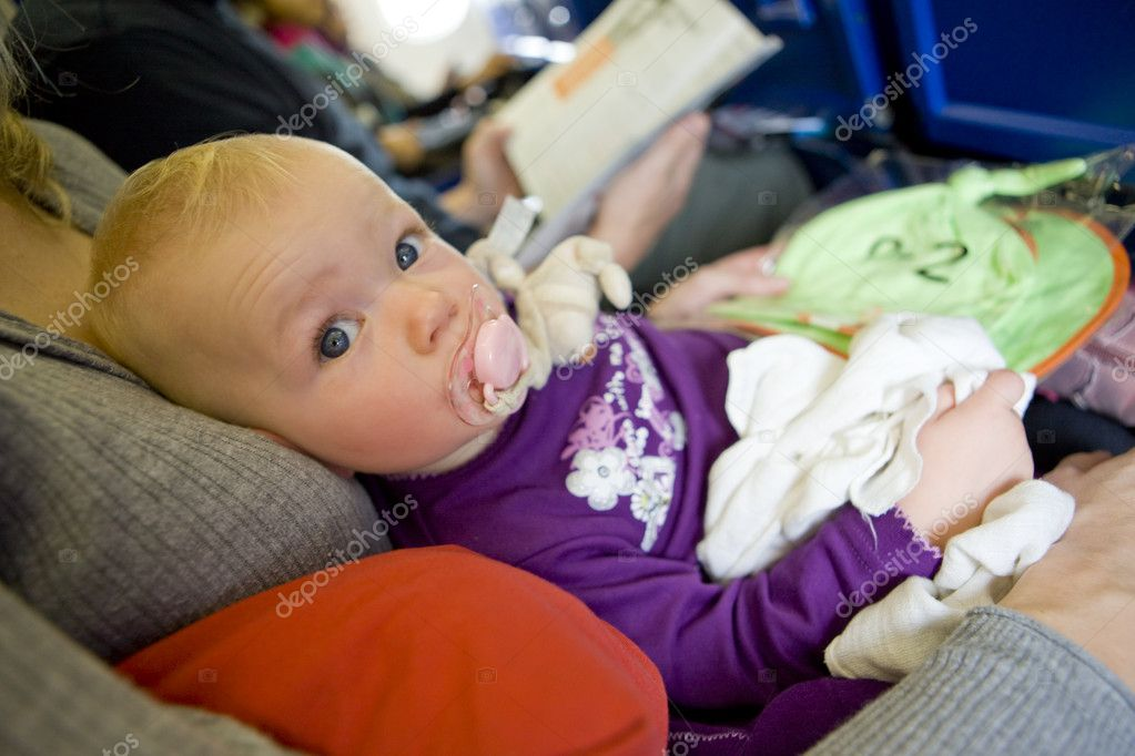 Toddler girl sitting on plane — Stock Photo #3373121