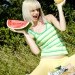 Woman with melons — Stock Photo
