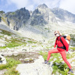 Woman backpacker in High Tatras — Stock Photo
