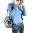 Woman wearing blue clothes with handbag — Stock Photo