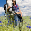 Equestrian with a horse on meadow — Stock Photo #3487448