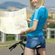 Royalty-Free Stock Photo: Biker holding a map, Czech Republic