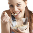 Stock Photo: Womeating cereals