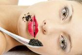 Woman with black caviar — Stock Photo
