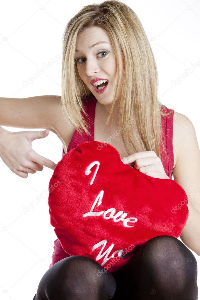 Sitting young woman with heart — Stock Photo #3488048