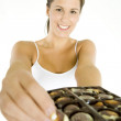 Woman holding chocolate box — Stock Photo