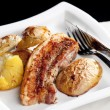Roasted pork meat with potatoes — Stock Photo