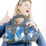 Portrait of sitting woman with handbag — Stock Photo