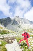Woman backpacker in High Tatras — Stock Photo