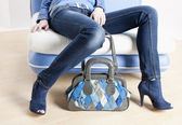 Detail of woman wearing blue shoes and with handbag — Stock Photo