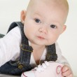 Baby girl holding a shoe — Stock Photo