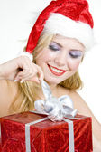Santa Claus with Christmas present — Stock Photo
