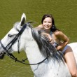 Stock Photo: Equestrian on horseback riding through water