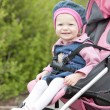 Toddler sitting in pram — Stock Photo #3603951