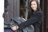 Portrait of equestrian with saddle — Stock Photo