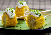 Cooked corn with garlic paste — Stock Photo