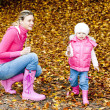 Mother with her daughter in autumnal nature — Stock Photo #3638927