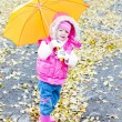 Little girl with umbrella - Stock Photo