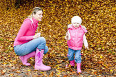 Mother with her daughter in autumnal nature — Stock Photo