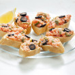 Salmon tartare with capers and black olives - Stock Photo