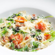 Pasta farfalle with Parma ham and cherry tomatoes — Stock Photo