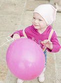 Portrait of toddler with pink balloon — Stock Photo