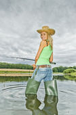 Woman fishing in pond — Stock Photo