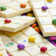 Still life of white chocolate with smarties — Stock Photo #3778390