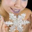 Stock Photo: Portrait of womwith snowflake