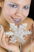 Portrait of woman with snowflake — Stock Photo