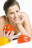 Portrait of lying down woman with peppers — Stock Photo