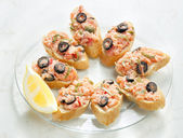 Salmon tartare with capers and black olives — Stock Photo