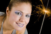 Woman with firecracker — Stock Photo
